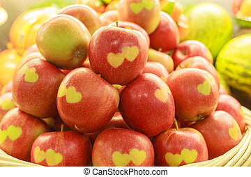 Apples with carved hearts - A basket of apples with heart...