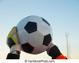 goalkeeper catches football / soccerball