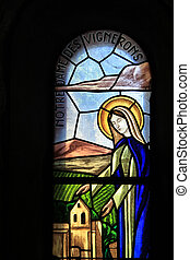 Stained glass church window in a church, Notre Dame des...