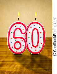 Burning birthday candles number 60