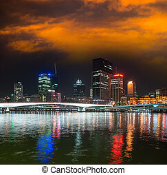 Brisbane skyline at night with river reflections