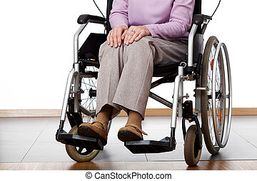 Woman on wheelchair - Elderly woman sitting on a wheelchair...