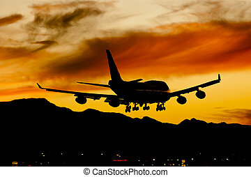 Aircraft Landing At Sunset - Commercial aircraft land at an...