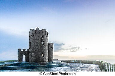 Cliffs of Moher at sunset - O Briens Tower in Co. Clare...
