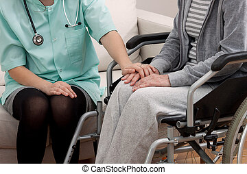 Doctor talking with aged patient - Doctor talking with aged...