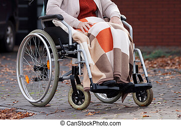 Disabled woman with blanket - Elderly woman on wheelchair...