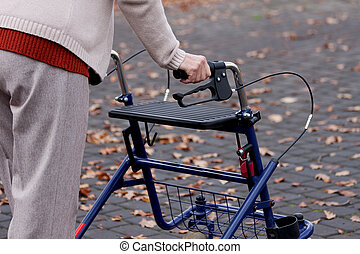 Woman with walker - Elderly woman using a walker on a street