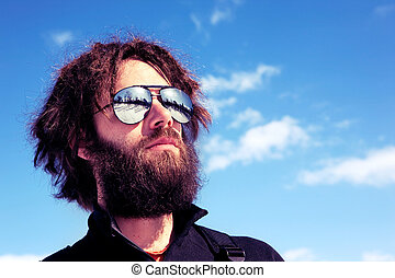 Male Adventurer - A male with a full beard and retro...