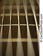 Strings - Macro of a 6-strings bass guitar
