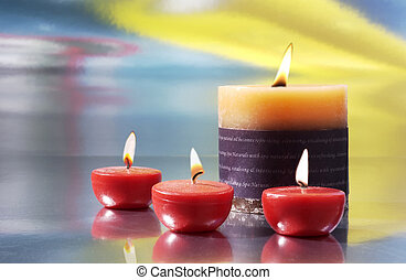 scented candles - three small red candles and a large candle...