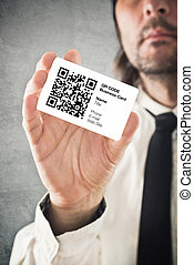 Businessman holding QR code business card