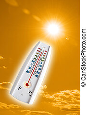 Hot sky - over 100 degree thermometer pointing to hot sun on...