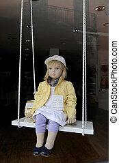 Manikin in a store front - Manikin child swing in a store...