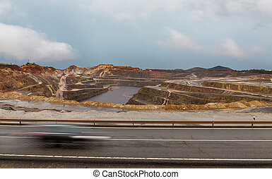 Rio Tinto mine and car trail - Copper mine open pit in Rio...