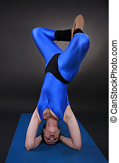 Headstand Triangle rotation - Woman doing yoga, Headstand...