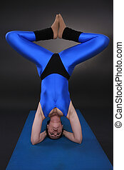 Headstand Triangle - Woman doing yoga, Headstand Triangle