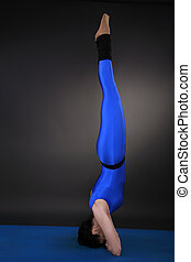 Headstand hands before the head - Woman doing yoga,...