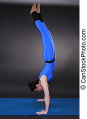 handstand - Woman doing yoga, handstand