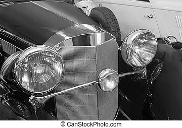 ancient black car close up monochrome