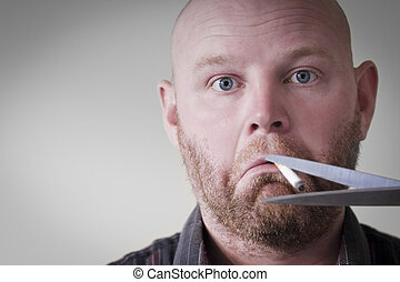 Quit Smoking - A scissors cuts the cigarette to a smoking...