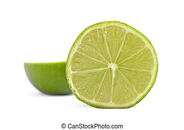 Divided Lime - Side view of a fresh sliced organic lime on...