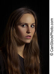 Woman Looking Serious - Studio shot of a young woman / girl...