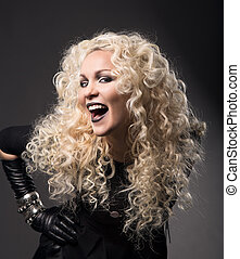 woman blonde curly hairs, surprised with open mouth black lips, beautiful fashion portrait over gray background