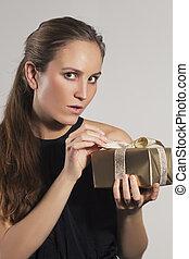 Woman Open Christmas Gift