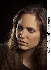 Serious Looking Young Woman Portrait - Studio shot of a...
