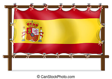 The flag of Spain attached to the wooden frame -...