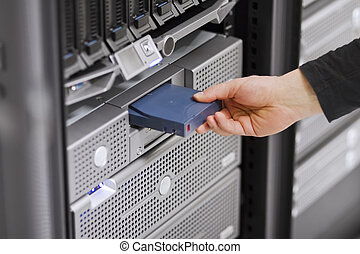 Running Backup - A close-up of a IT engineer technician...