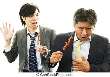 Man throwing up - Frowning man with drunken man