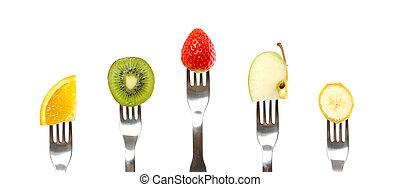 Healthy Organic Fruit - Fresh organic fruit on forks on...