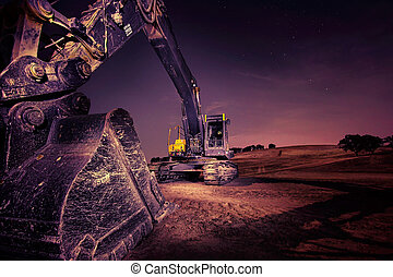 Excavator - A large excavator at night