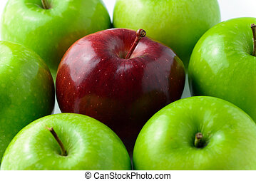 Standing out - Red apple in the middle of green apples for...