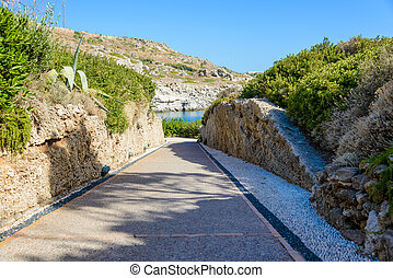 stone paved road leading to the bay