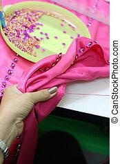 Dressmaker - Close-up of a dressmaker sewing a garment.