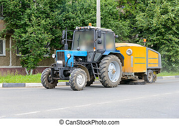 tractor cleans the street