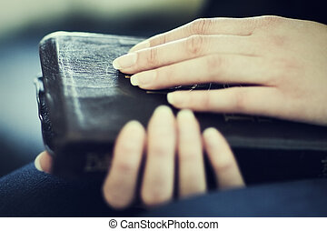 Women Holding a Bible - A close-up of a christian woman...