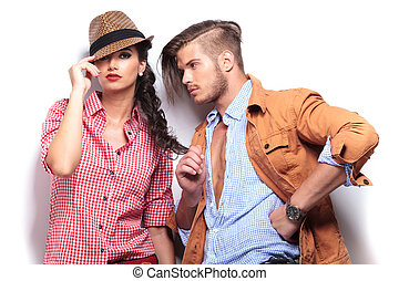 relaxed man playing with girlfriend's hair