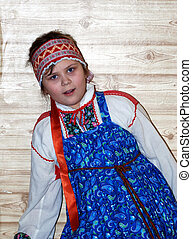 russian girl in traditional clothes in russian house izba