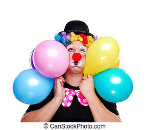 Birthday clown holding balloons on white background