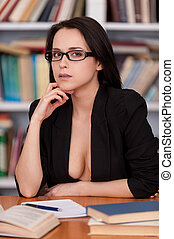 Motivation to study. Beautiful young woman in glasses and...
