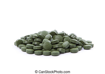 Chlorella tablets - A pile of Chlorella pills. Isolated on...