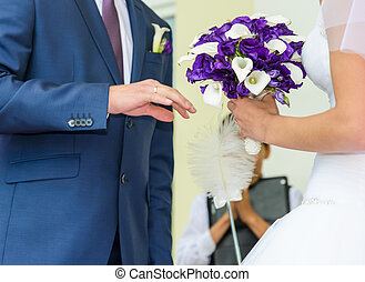 wedding Ceremony - the groom in a blue suit and a bride...