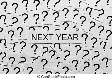 What will happen next year? - Many question marks on paper....