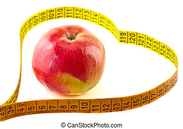 Measuring tape a heart-shaped with a red apple