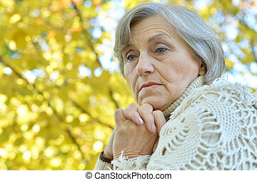 Beautiful elderly woman at nature - Portrait of a beautiful...
