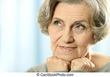 Portrait of a middle-aged woman isolated on blue