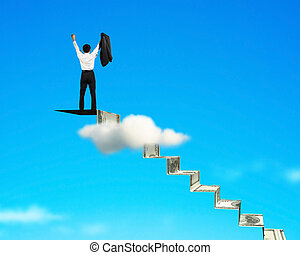 man cheering on top of money stairs